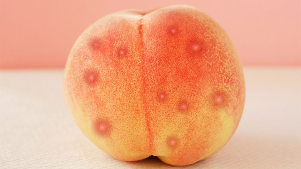 a peach covered in dots